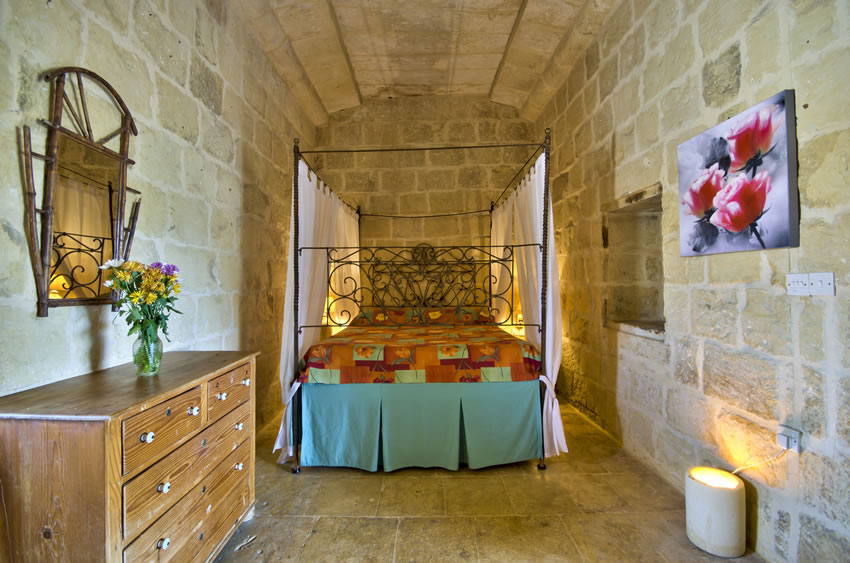 Main bedroom with a traditional Maltese bed